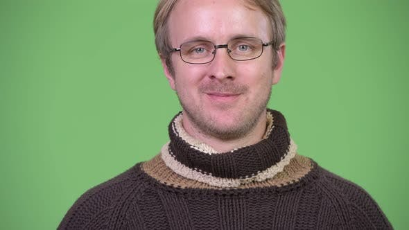 Thumbnail for Happy Handsome Man Wearing Turtleneck Sweater and Eyeglasses