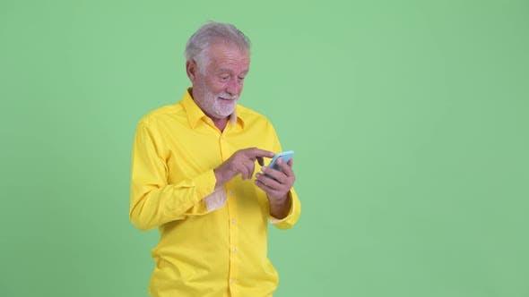 Thumbnail for Happy Senior Bearded Businessman Using Phone