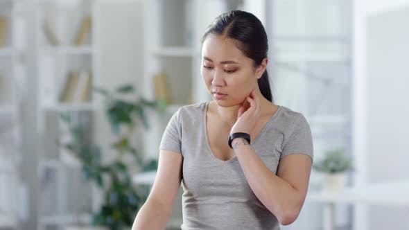 Thumbnail for Woman Checking Pulse with Augmented Reality Smart Watch at Home