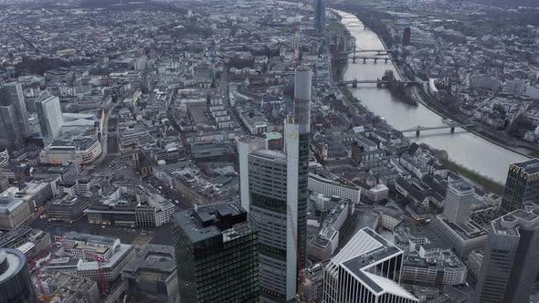 Thumbnail for AERIAL: Epic View of Frankfurt Am Main, Germany Skyline Commerzbank Tower on Cloudy Grey Winter Day