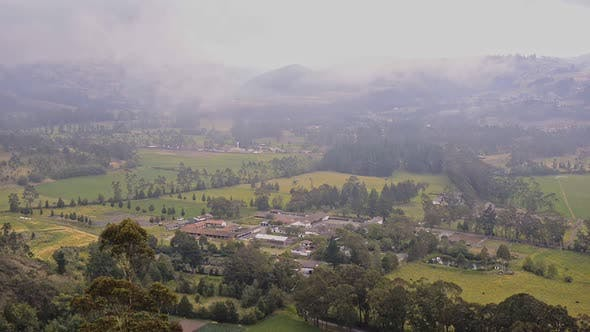 Andes landscape view, with a village surrounded by cultivated fields, at dusk, Ecuador