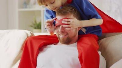 Girl Wearing Father Superhero Mask