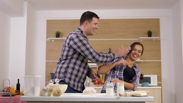 Thumbnail for Happy Smiling Couple Playing with Each Other in the Kitchen