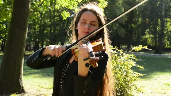 Thumbnail for Young Attractive Woman Play on the Violin in the Park - Closed Eyes - Passion