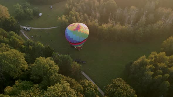 Thumbnail for Aerial View of Colorful Hot Air Balloon Prepare for an Summer Early Morning Flying in Park in Small