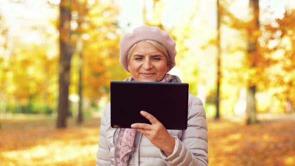 Thumbnail for Senior Woman with Tablet Pc at Summer Park 25