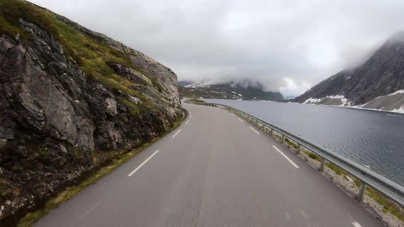 Thumbnail for Vehicle Point-of-view Driving a Car on a Road in Norway