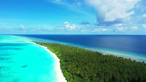 Wide angle birds eye abstract shot of a sunshine white sandy paradise beach and aqua blue ocean