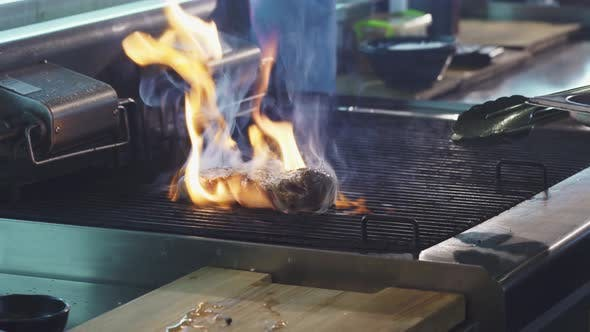 Thumbnail for Close Up Shot of a Pork Meat on the Grill in Flames of Fire