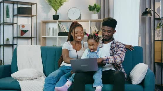 Afro American Family Playing Games on Laptop at Home