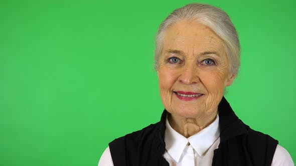 Thumbnail for An Elderly Woman Smiles at The Camera