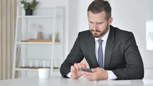 Thumbnail for Businessman Using Smartphone for Online Trading