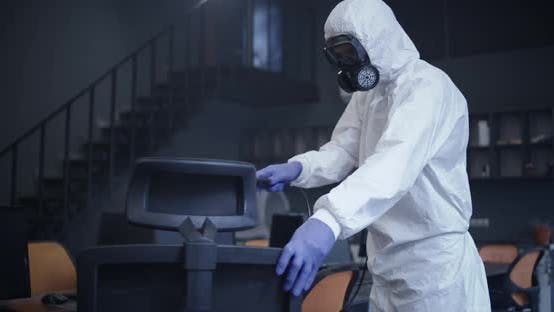 Thumbnail for Men in Hazmat Suits Disinfecting Office