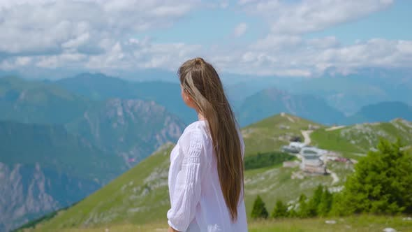 Moving Around Girl on the High Mountains of the Alps