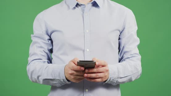 Thumbnail for Front view of a man hands texting