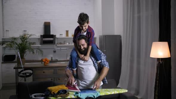 Thumbnail for Joyful Family Doing Household Chores Together