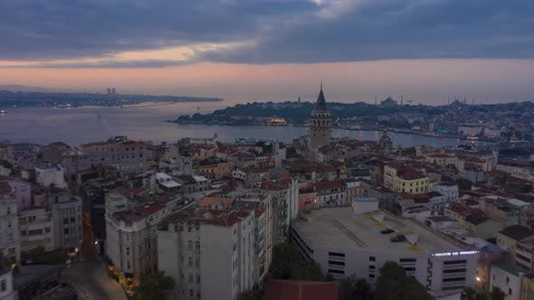 Thumbnail for Galata Tower in Center of Istanbul Night To Day with Bosphorus and Istanbul Skyline, Aerial