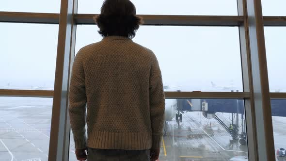 Thumbnail for Passenger Comes to Window to Look at airplane at Airport