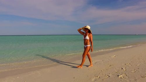 Modern Fun Woman Traveling Spending Quality Time on The Beach on Summer White Sand and Blue