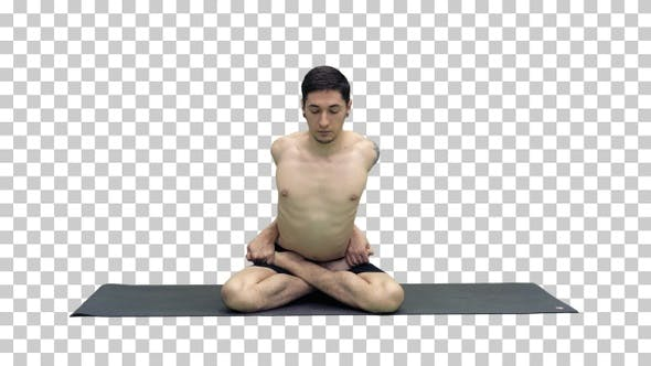 Thumbnail for Sporty beautiful young man practicing yoga sitting cross-legged