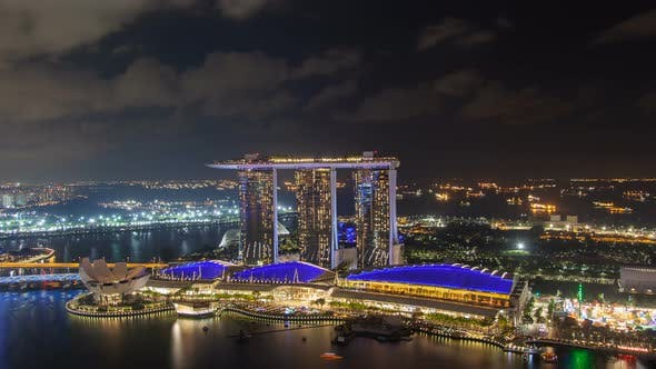 Thumbnail for Aerial Singapore's Skyline at Night, Overview of Marina Bay and Garden Timelapse