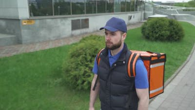 Courier with a Thermo Bag Delivers Food To the Office, the Process of Food Delivery, Food Delivery