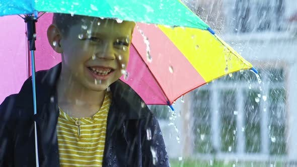 Thumbnail for Little Boy Catching Raindrops