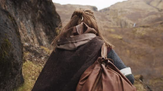 Woman In Mountainous Landscape