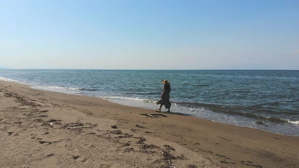 Thumbnail for Girl Walking Alone at Long Seashore