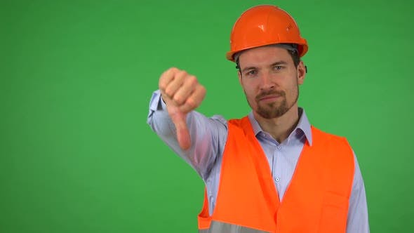 Thumbnail for A Young Construction Worker Shows a Thumb Down To the Camera and Shakes His Head - Green Screen