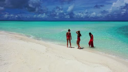 Beautiful fun women on vacation spending quality time at the beach on paradise white sand and blue 4