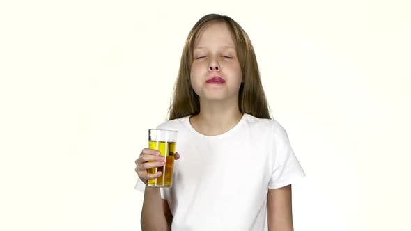 Thumbnail for Girl Drinks Apple Juice, Licks Her Lips After the Juice. White Background. Slow Motion