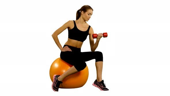 Thumbnail for Girl Sitting on Pilates Ball and Exercising with Dumbbells. White Background
