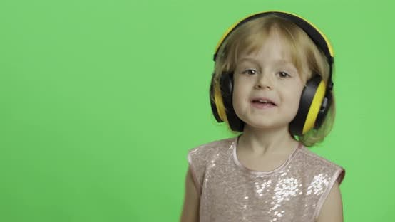 Thumbnail for Girl in Glossy Dress and Headphone Listening To Music and Dancing. Chroma Key