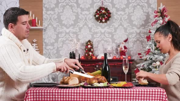 Thumbnail for Husband Slicing a Grilled Chicken at the Christmas Dinner