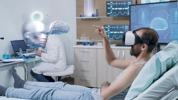 Thumbnail for Patient Wearing VR Headset Looking at Brain Scan in AR Hologram in Front of Him