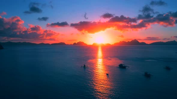 Thumbnail for Boats Silhouette in the Sea on Sunset and Isles Background. Scenic Evening Sky Above Sea