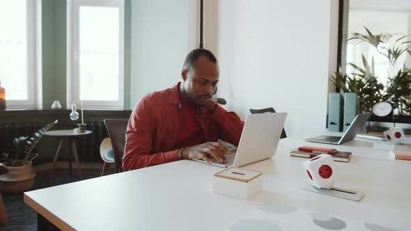 Thumbnail for Young African American Man Working on Laptop in Office