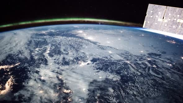 Thumbnail for Aurora and Cities at Night seen from International Space Station