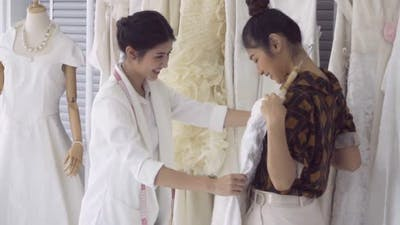 Future Bride Customer Talking with Wedding Store Shopkeeper
