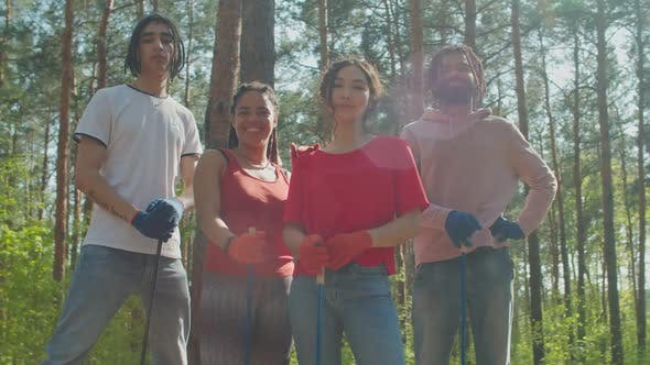 Charity Eco Activists with Tools Posing in Forest