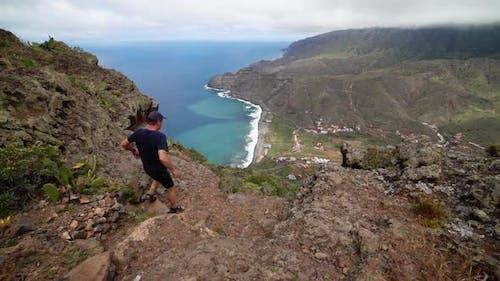 Man Walking On Mountainside
