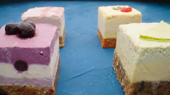 Thumbnail for Raw Vegan Desserts on a Blue Table
