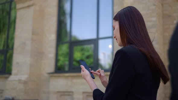 Thumbnail for Businesswoman Scrolling Mobile Phone Outdoor