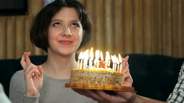 Thumbnail for Young Girl Blowing Candles on Birthday Cake