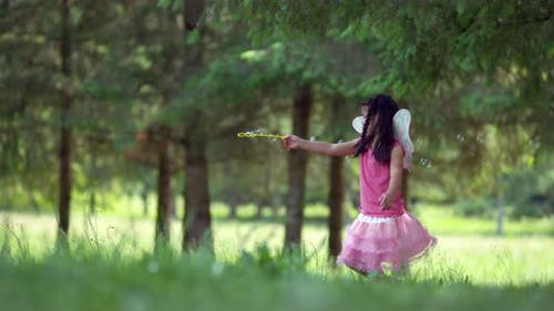 Slow motion, girl waves bubble wand, shot on Phantom Flex 4K