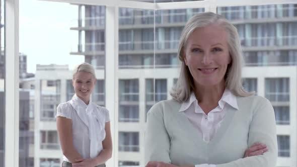 Thumbnail for Two businesswomen in office, portrait
