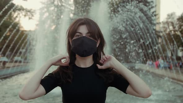 Thumbnail for Woman is wearing face protective mask