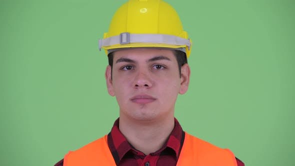 Cover Image for Serious Young Multi Ethnic Man Construction Worker Nodding Head No