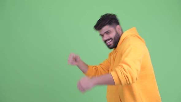 Thumbnail for Happy Young Overweight Bearded Indian Man Touching Something and Dancing